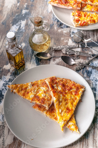 Fotografie, Obraz  Tasty pizza on a plate on a wooden table