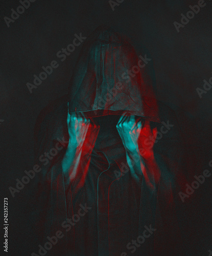 Photo Anaglyph effect of human in black coat with a hood.