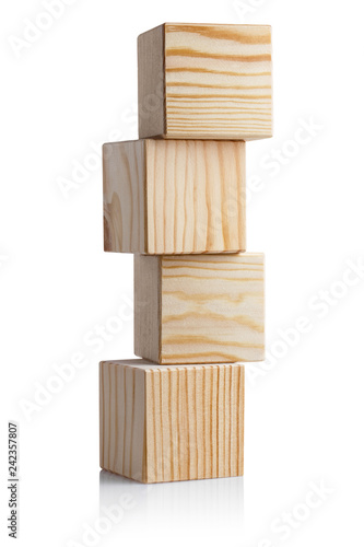 Photo Tower of four wooden cubes, isolated on white background