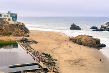 Ruins Of The Sutro Baths On A Cloudy Day; The Cliff House In The Background, Lands End, San Francisco, California