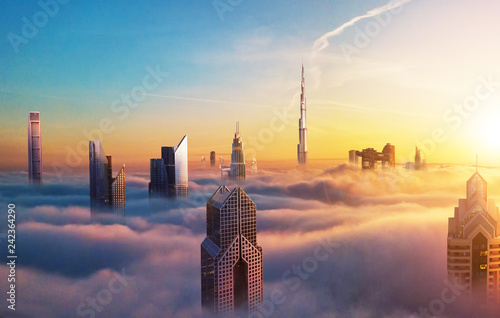 Foto auf Gartenposter Stadtgebaude Dubai sunset view of downtown covered with clouds