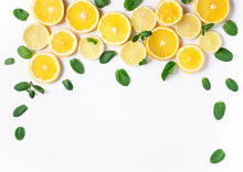 Photo Of Orange And Lemon Slices With Mint On A White Background. Background For The Design Of Banners, Websites, Blogs, Information Block. Frame For Banner With Orange And Lemon