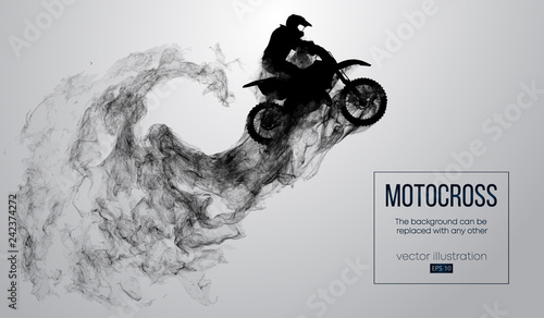 Photo  Abstract silhouette of a motocross rider on white background from particles, dust, smoke, steam