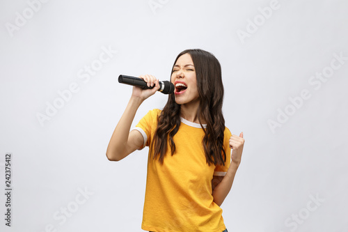 Valokuvatapetti beautiful stylish woman singing karaoke isolated over white background