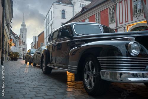 Foto op Aluminium Vintage cars Old car on European city old street