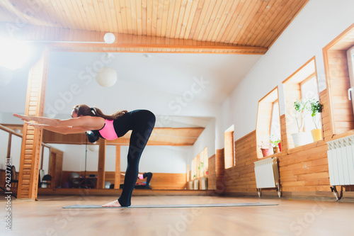 Sporty Woman Practicing Yoga Standing Forward Bend Exercise Head To Knees Uttanasana Pose Working Out Wearing Sportswear White Loft Studio Background