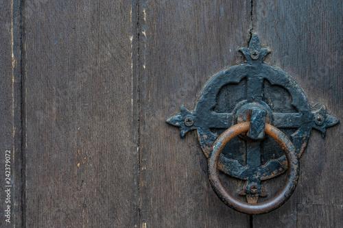 Fotografie, Obraz  Vintage black door panels with ancient knocker - high quality texture / backgrou