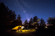 Family Tent On Camping Ground Under Stars