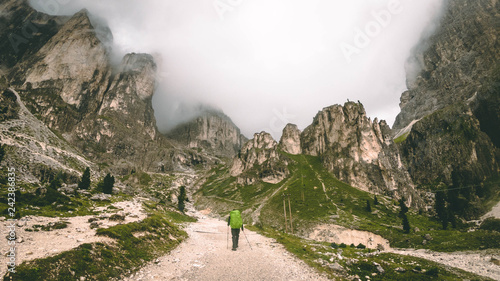 Photo Stands Road in forest Mountaineer hiking the Dolomites