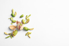 Composition With Organic Pistachio Nuts On White Background. Space For Text