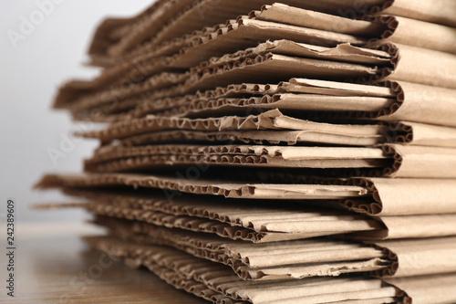 Fotografía  Recycling cardboard pile on light background, closeup