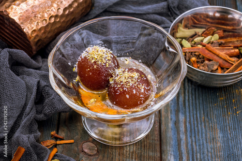 the Gulab jamun indian food on wooden background