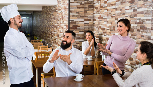 Happy chef listens to praise of the food Wallpaper Mural