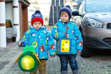 Two Little Kids Boys Holding S...