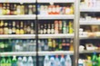 photo blurred Drink products Beverage soft drink bottles in supermarket refrigerator Variety of drinks on shelves in convenience store background. blur Leave copy space empty to write text