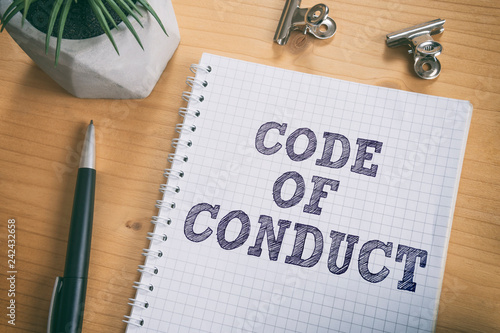 Code of Conduct text on notebook Wallpaper Mural
