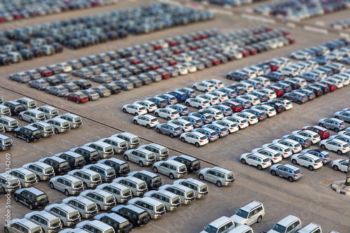 Photo  Dubai, UAE - January 03, 2017:  New cars in rows stored at port Rashid in Dubai,