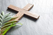 canvas print picture - Easter wooden cross on black marble background religion abstract palm sunday concept