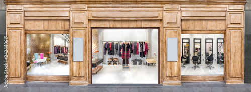 Outdoor mockup,store template,front view wooden shop facade with windows display and posters. Clothes shop and hair salon.