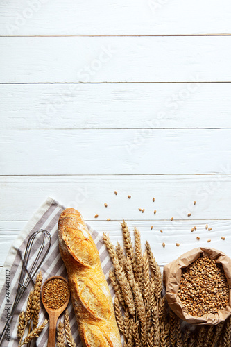 Foto op Canvas Bakkerij Still life with bread, flour and spikelets