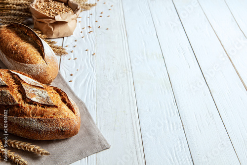 Photo sur Toile Boulangerie Still life with bread, flour and spikelets