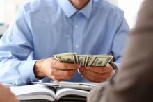 The Businessman Considers Cash...