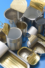 Tin Cans Isolated On Blue Background