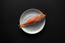 Red Fish On Plate With Salt