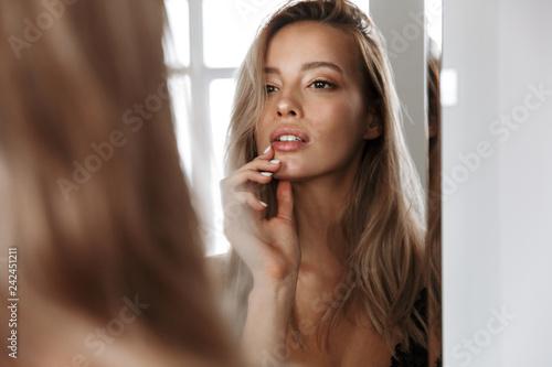 Beautiful young blonde woman wearing lingerie
