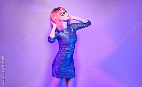 988bb135 Glamour young woman dance in neon light. Disco Girl with Pink Dyed Hair in  Trendy