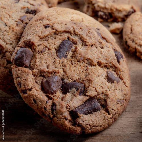 Chocolate chip cookies on rustic wooden background