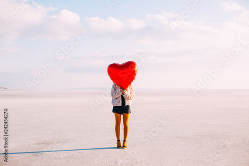 Photo  Young Woman Holding Red Heart Shaped Balloon