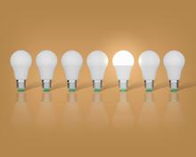 7 Light Bulbs On A Beige Background, One Had An Idea
