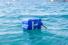 Blue Drum Floating In The Sea