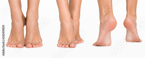 Foto Set of female feet from different directions isolated on white