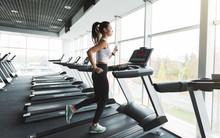 Sports Woman Training On Tread...