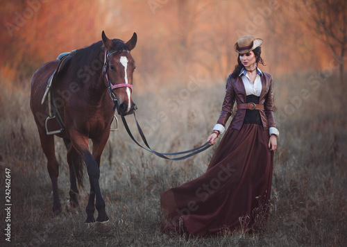 Foto  A woman in a historical suit walking with a horse