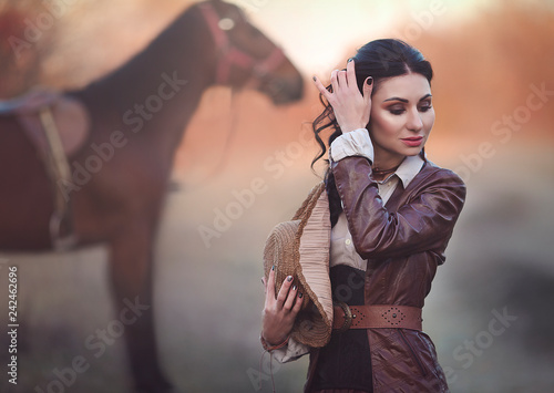Fotografie, Obraz  A woman in a historical suit walking with a horse