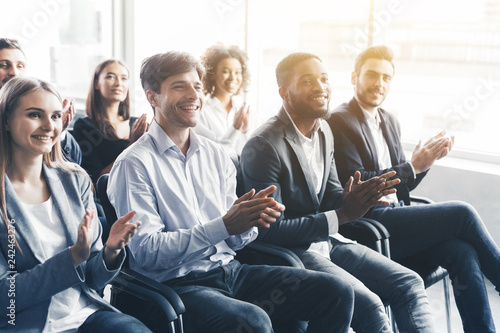 Happy diverse audience applauding at business seminar Canvas Print