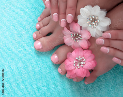 Poster Pedicure Beautiful pink manicure and pedicure with flowers