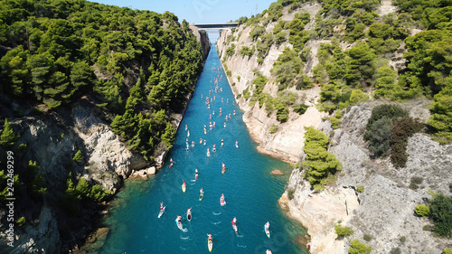 Valokuva  Aerial bird's eye view photo taken by drone of stand up paddle surfing or SUP co