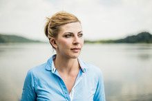 Portrait Of Woman At A Lake Looking Sideways