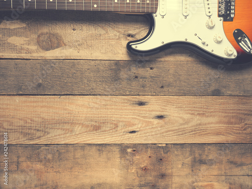 Old vintage guitar on rustic wood - 242478614