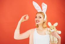 Egg Hunt. Easter Eggs As Traditional Food. Spring Holiday. Girl With Hare Toy. Woman In Rabbit Bunny Ears. Happy Woman In Bunny Ears With Toy. Happy Easter. Easter Dinner. Copy Space