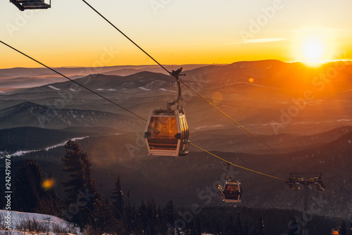 Canvas Prints Helicopter ski lift at sunset in the ski resort