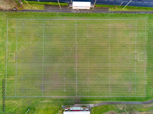 Fotografie, Obraz  Aerial drone view of a Rugby Union sports pitch marked out in a Wales Park befor