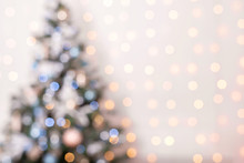 Blurred Golden And Blue Festive Lights On Christmas Tree.