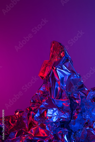 Foto op Canvas Violet Mountain landscape made of aluminium foil - colorful light