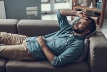 Adult Man Lying On The Sofa An...