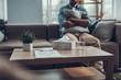 Selective focus of coffee table and man sitting with his pillow